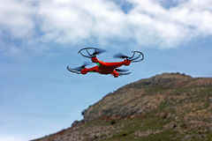 Flying drone with mounted camera Stock Image