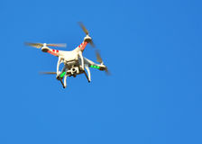 Flying drone with mounted camera Stock Photo