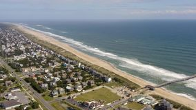 Aerial view of town, ocean and beach. 4k. Flying with drone near fancy house in Avon, NC, USA. Aerial footage of ocean, beach and city stock video footage