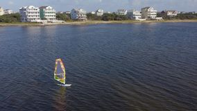 Windsurfing. Sportsmen beginner. 4k. Flying with drone near fancy house in Avon, NC, USA. Aerial footage of ocean, beach and city stock video footage