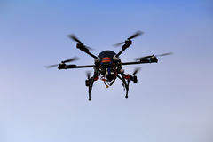 Flying drone with an octocopter for video and photo productions Stock Photography