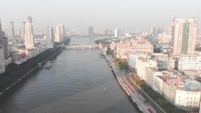 Flying drone over Guangzhou city. The falling shadow of the skyscrapers stock footage