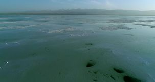 Drone flight over the Chaka Salt Lake stock video footage
