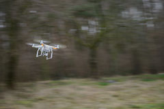 Flying drone in panning motion Stock Photography