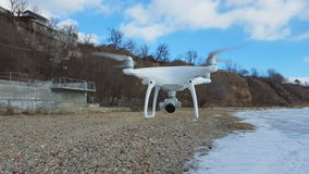 Flying drone quadcopter Dji Phantom 4 with high resolution digital camera. Rostov - on - Don, Russia - January 22, 2017: Flying drone quadcopter Dji Phantom 4 stock video
