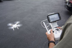 Flying drone with remote GPS Stock Photos