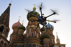 Flying drone in the skies of Moscow. A flying hexacopter without a camera shot from below with the blue skies and blured features of Red Square in the background Stock Photography