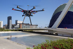 Flying drone in the skies of Valencia. A flying drone without a camera with a blured out architectural ensemble of Valencia Stock Photography