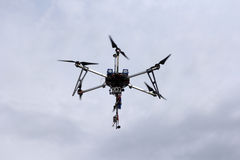 Flying  drone in the sky with mounted  digital camera Royalty Free Stock Image