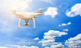 Flying drone with stabilizer camera outdoor on the sky. Stock Images