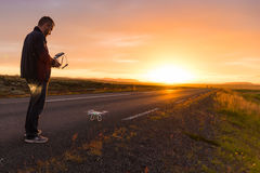 Flying a drone on sunrise Stock Photos