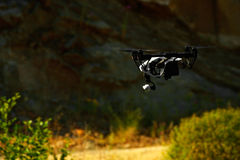 Flying with a drone for video and photo stock images