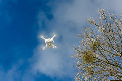 Flying drone in a winter royalty free stock image