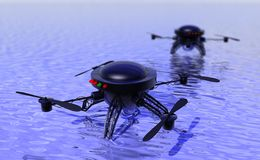 Flying drones investigating water surface Stock Image