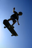 Flying Dude. Boy flying on skateboard royalty free stock photos