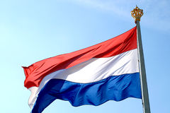 Flying dutch flag and crown. Dutch flag, flying in the wind Stock Photography