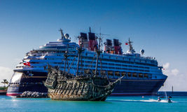 Flying Dutchman Beside DisneyCruise Line's Wonder in Castaway Cays Lagoon Royalty Free Stock Photos