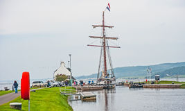 Flying Dutchman leaving Canal. Flying Dutchman, tall ship, leaving the Caledonian Canal and entering the Beauly Firth heading towards the Moray Firth and North stock photography