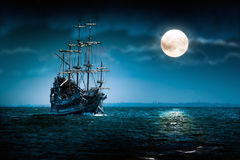 Flying Dutchman pirate ship. Sailing pirate ship on the high seas in the night. Old moonlit Flying Dutchman sailing