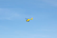 Flying emergency rescue helicopter Stock Photography
