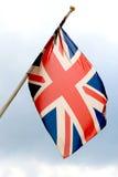 Flying english flag stock photography