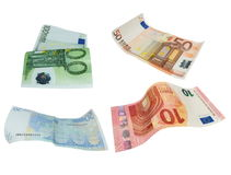 Flying Euro banknotes isolated on white background, with clipping path Royalty Free Stock Photo