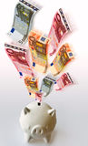 Flying Euro banknotes with white piggy bank Stock Photography