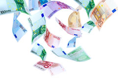 Flying Euro money. Falling Euro banknotes on a white background Stock Images