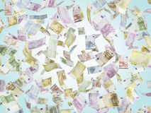 Flying EURO notes over blue background. Close up Royalty Free Stock Images