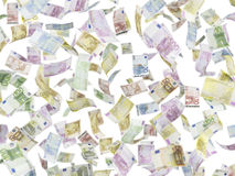 Flying EURO notes over isolated background. Close up Stock Image