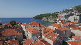 Flying through european old town with red tile rooftops stock video footage