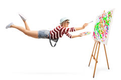 Flying female painter drawing a painting Stock Photography