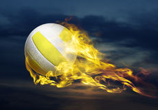 Flying fiery ball. Flying fiery volleyball ball in sky Royalty Free Stock Photo