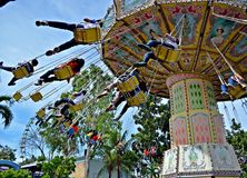 Flying Fiesta. Fun times with friends. First time jitters for this ride Royalty Free Stock Photos