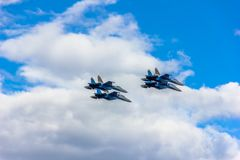 Flying fighters in the sky royalty free stock photo