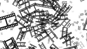 Flying film tape fragments in black on white. In backgrounds stock footage