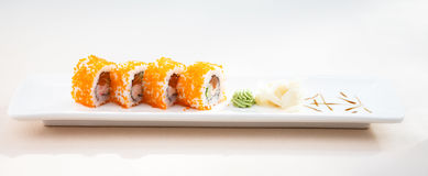 Flying fish roe maki. With wasabi and ginger Stock Photo