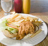 Flying fish sandwich Caribbean style Barbados. Flying fish sandwich Caribbean style French fries lettuce tomato photographed in St. Lawrence Gap Barbados Stock Image