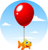 Flying fish tied to a big cute red balloon Royalty Free Stock Photography