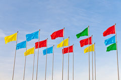 Flying flag. Colorful flying flag under blue sky Stock Photos