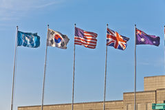 Flying flag. Five flying flag under blue sky, United Nations, Korea, United States, United Kingdom, Australia Stock Photo