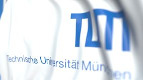 Flying flag with Technical University of Munich emblem, close-up. Editorial loopable 3D animation. Waving flag with Technical University of Munich emblem stock footage