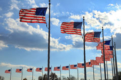 Flying flags. Circle of flags at the washington monument in washington, dc, usa royalty free stock images