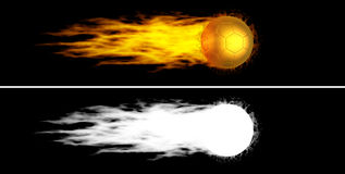 Flying flaming golden soccer ball. Flying golden soccer ball with fiery tail. Alpha channel is included Stock Photo
