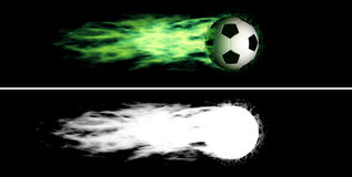Flying flaming soccer ball. Flying soccer ball with a green fiery tail. Alpha channel is included Stock Photo