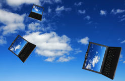 Flying flock of laptops Stock Photography