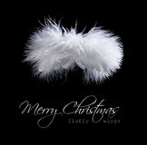 Flying fluffy christmas angel. Abstract greeting card in black and white Stock Photo