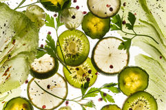 Flying food - kiwi, lime, parsley, sald, brussel sprouts Royalty Free Stock Photography