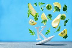 Flying foods rich in vitamin k. Green vegetables Royalty Free Stock Images