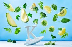 Flying foods rich in vitamin k. Green vegetables Stock Photography
